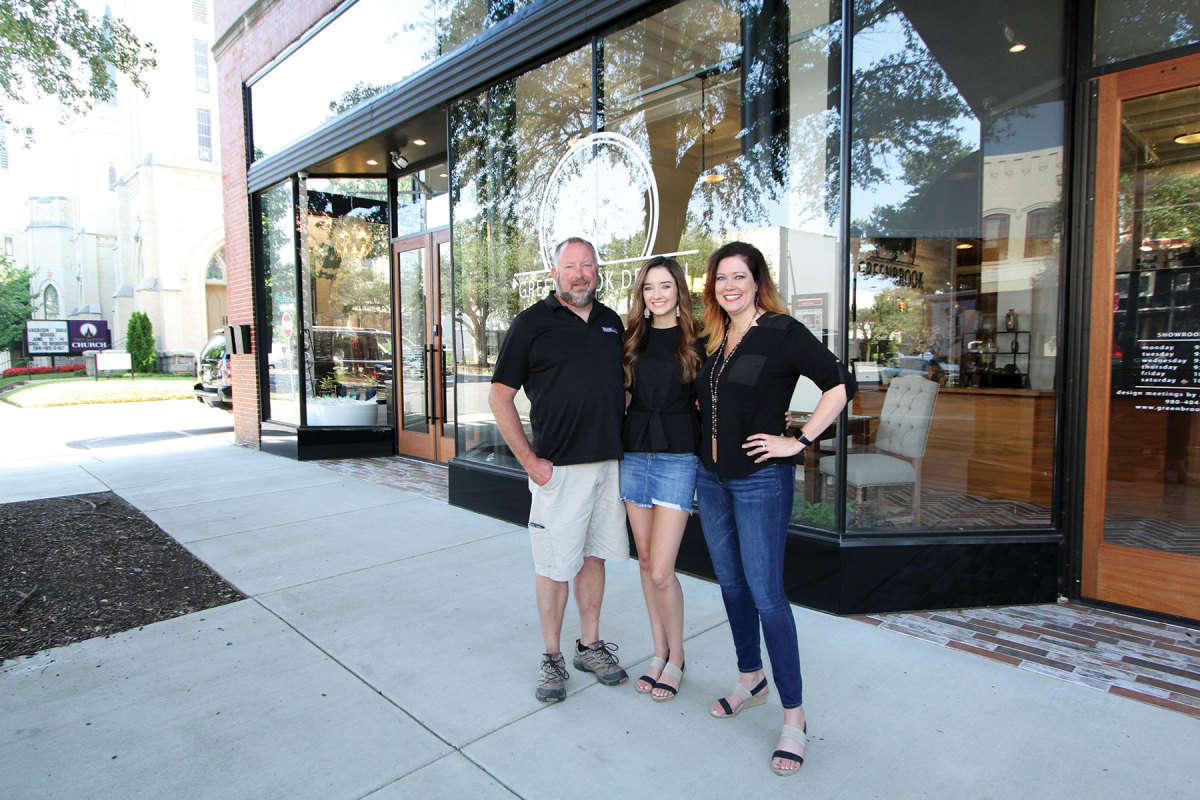 Travis, Taylor and Stacey Walker in front of Greenbrook Design.