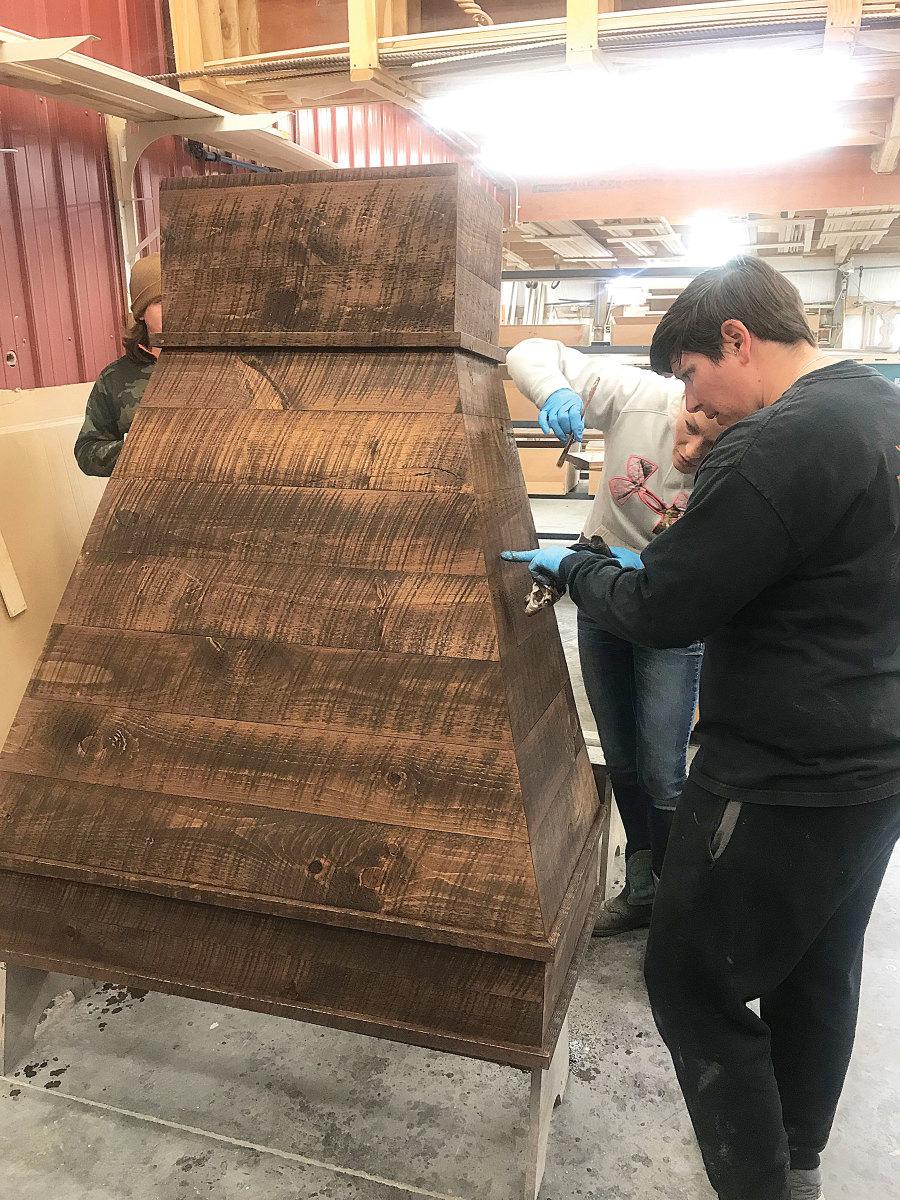Walker Woodworking's  Natalyn Blanton and Gamble Northropinspecting a range hood