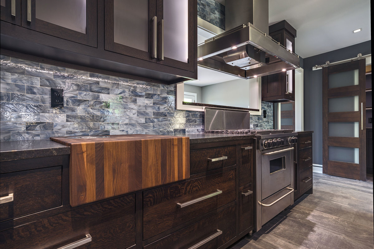 Moderm, dark-hued kitchens are trending in SAM's market.