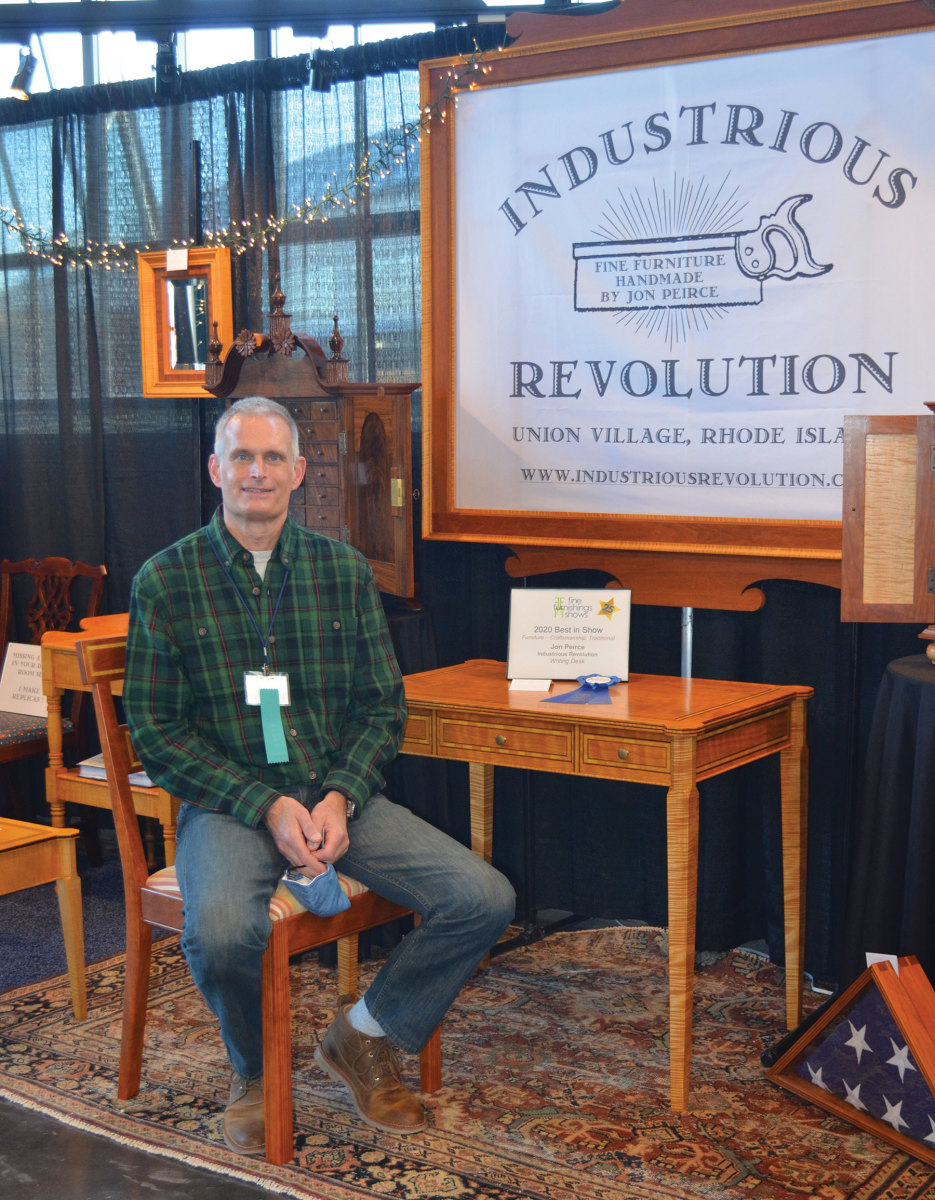 Jon Peirce with his curly cherry Sheraton writing desk, winner of the Providence show's best traditional furniture craftsmanship award.