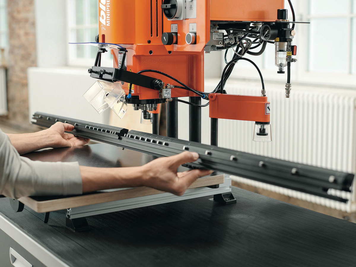Blum's EasyStick automatic stop and the AvanTech YOU drawer system from Hettich America.