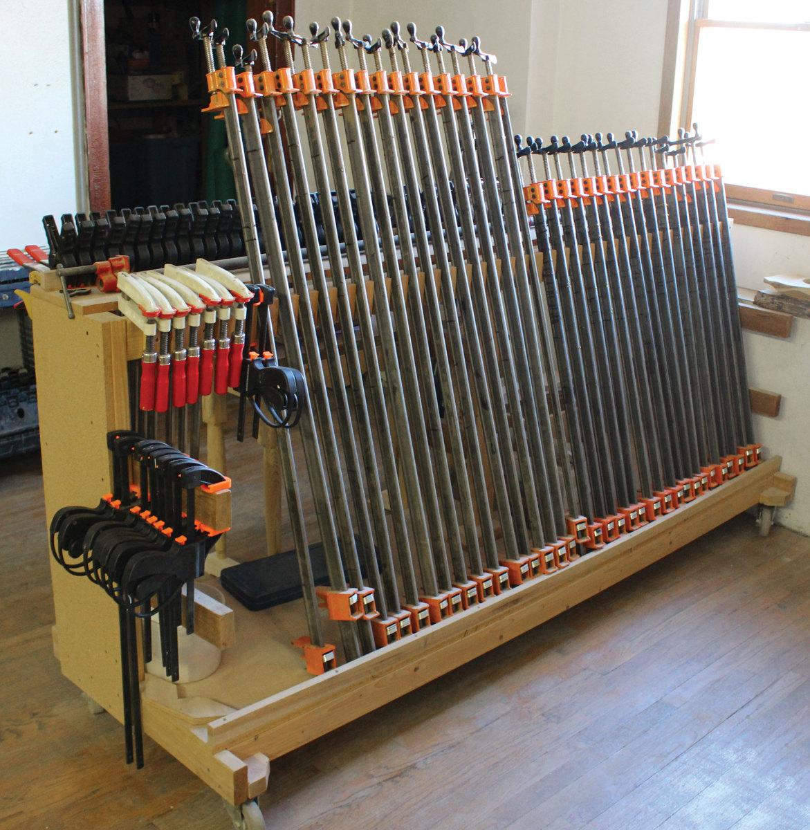 A portable clamp rack built on a 2x4 base.