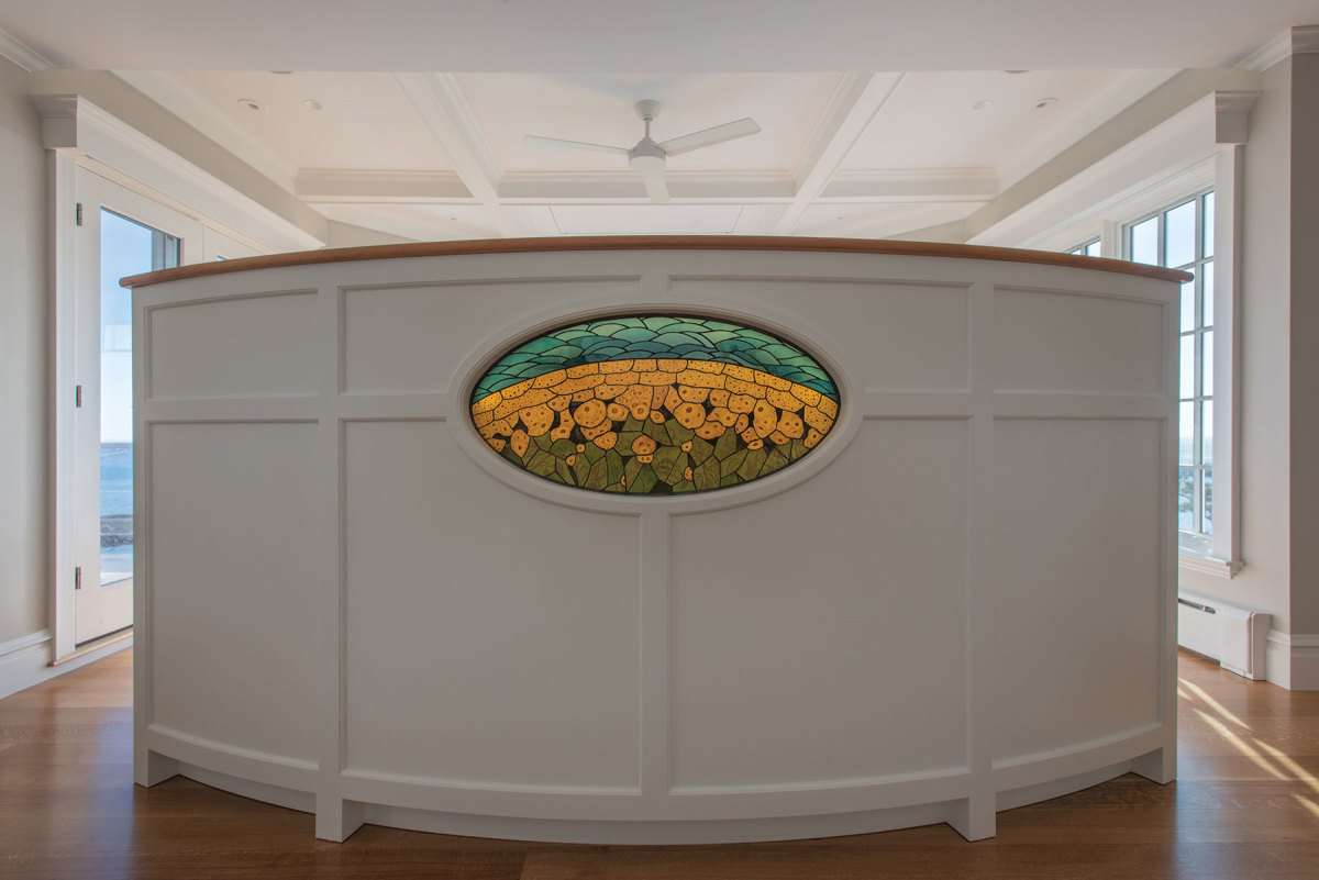 This job called for a curved  divider with stained glass.