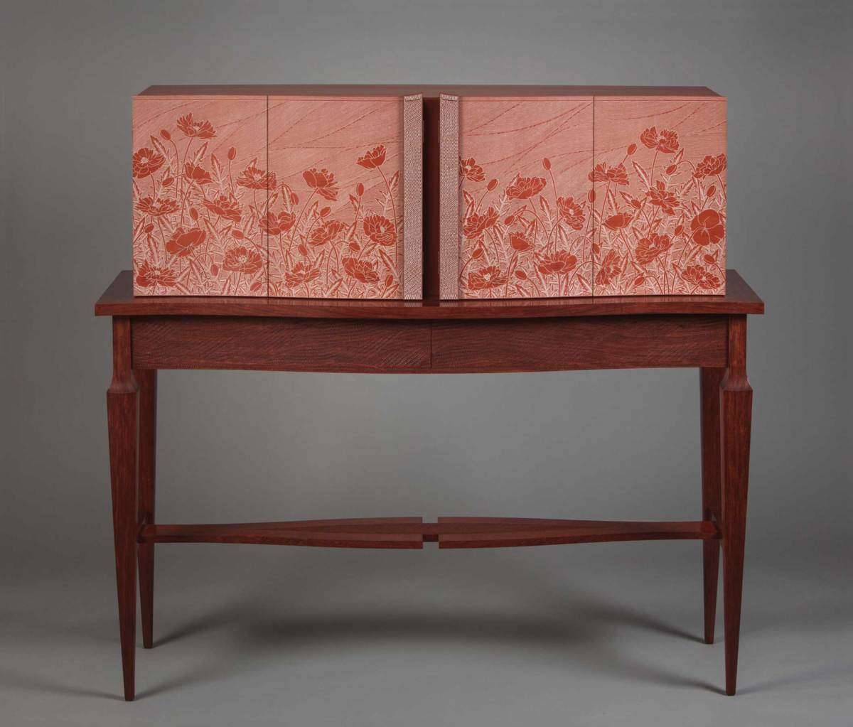 "Kristina Madsen will receive the Award of Distinction at The Furniture Society's upcoming conference in Asheville, N.C. At left is Madsen's ""Poppy Cabinet""."