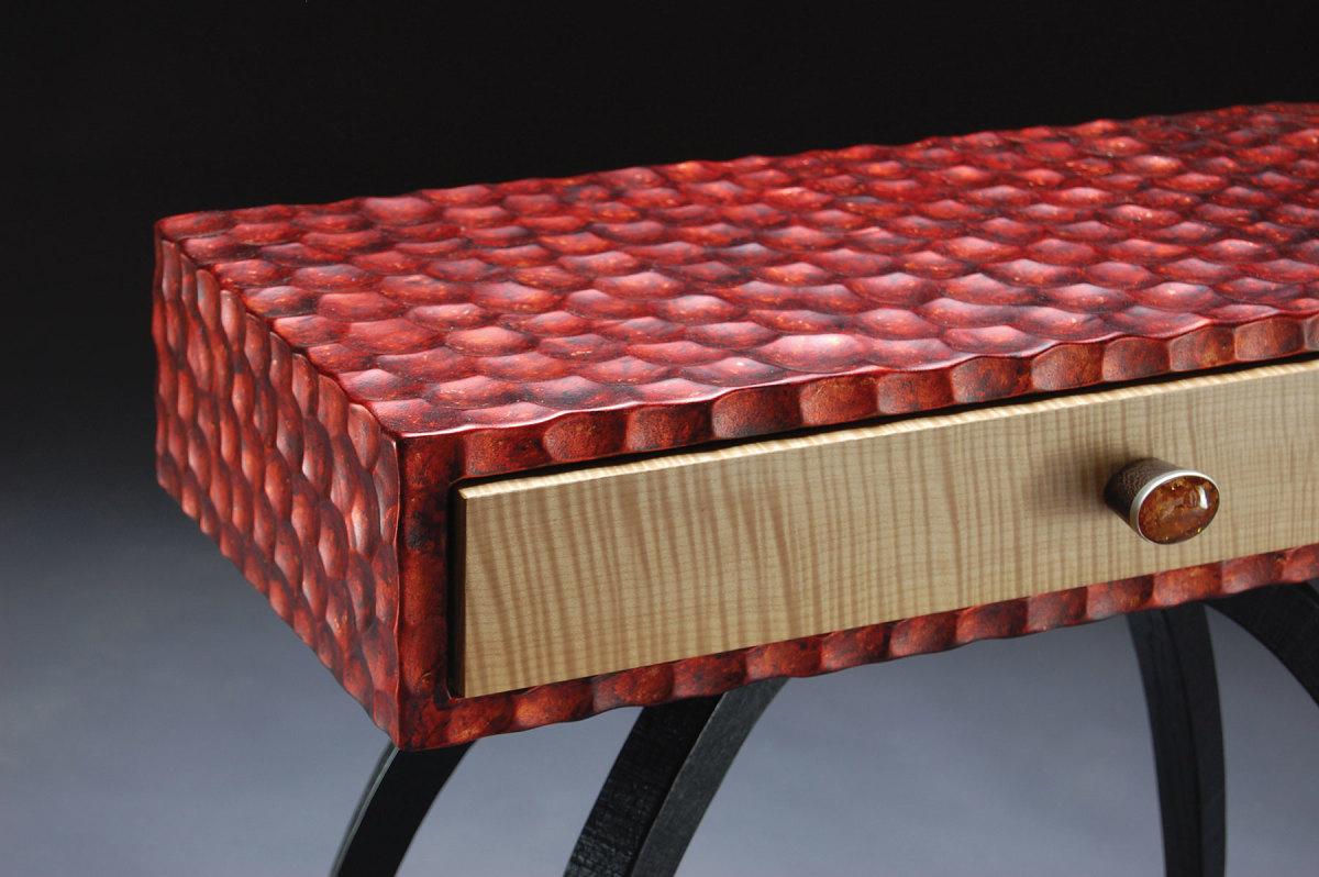 Textures also distinguish his sculptural art furniture.