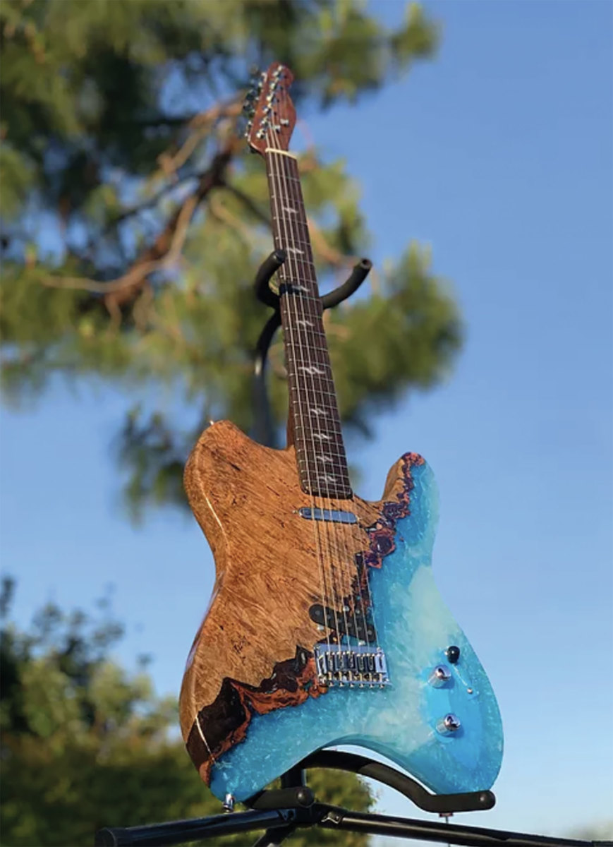 """""""Coastline Telecaster Guitar"""" by Max Shen, all prize-winning entries in the Woodcraft """"Pour to Win"""" contest."""