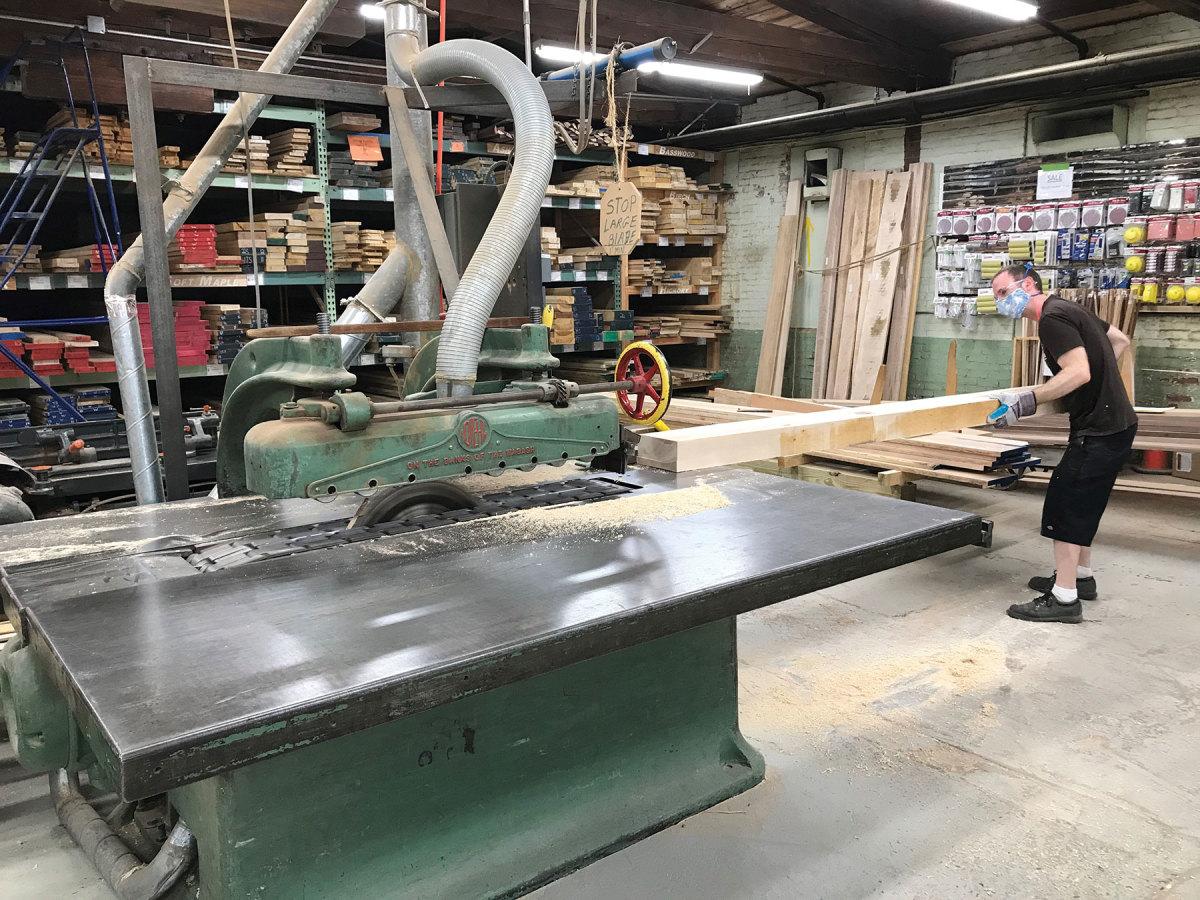 Matt Laflamme operates the shop's rip saw.